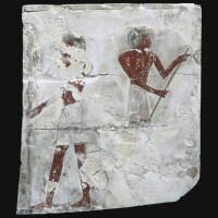 9. an egyptian polychrome limestone relief fragment, early 18th dynasty, circa 1540-1400 b.c.
