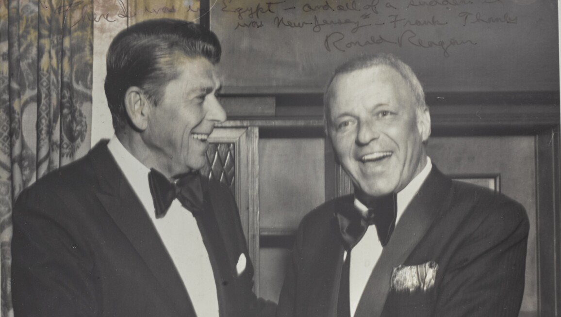 Photograph Of Ronald Reagan And Frank Sinatra Shaking Hands
