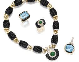 11. group of 18 karat gold, diamond, onyx and colored stone jewelry