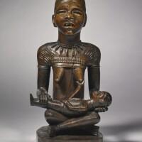 5. kongo-yombe maternity figure by the master of kasadi,democratic republic of the congo