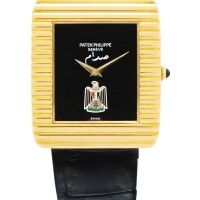 19. patek philippe   reference 3733 a yellow gold wristwatch with onyx dial and iraqi coat of arms, made in1979
