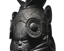 26. mende helmet mask (ndoli jowei) by the master of nguabu, sierra leone