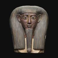 4. an egyptian polychrome wood mummy mask, 25th/early 26th dynasty, circa 750-600 b.c. | an egyptian polychrome wood mummy mask