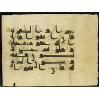 5. a large illuminated qur'an leaf in kufic script, near east or north africa, late 9th century ad