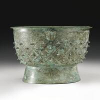 59. an archaic bronze ritual food vessel (yu) late shang dynasty, 13th-11th century bc
