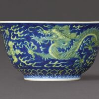 3105. a blue and white and yellow-enamelled 'dragon' bowl seal mark and period of qianlong |