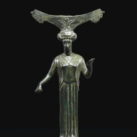 13. a greek bronze mirror handle, 5th century b.c. | a greek bronze mirror handle