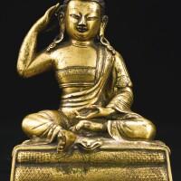 410. a gilt-bronze figure of milarepa tibeto-chinese, 18th century