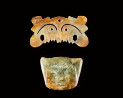 5004. a jade 'toothed animal mask' ornament and a green jade 'face' pendant neolithic period, hongshan culture |