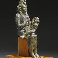 11. an egyptian bronze figure of isis with horus, 25th/26th dynasty, 750-525 b.c.