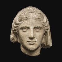 15. a cypriote limestone head of a woman, circa 2nd/1st century b.c. | a cypriote limestone head of a woman