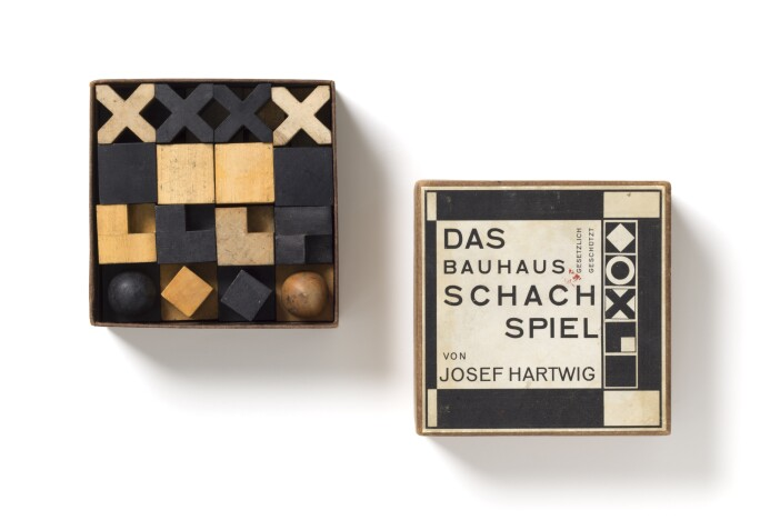 chess pieces from Josef Hartwig's chess set in their box