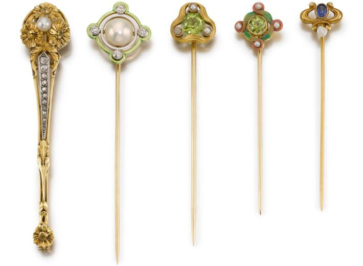 Diamond and Gem Stick Pins in an auction selling gentlemen's accessories