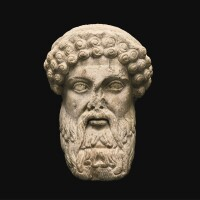 21. a fragmentary roman marble herm head of hermes, circa 2nd century a.d. | a fragmentary roman marble herm head of hermes