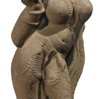 909. a pink sandstone figure of a yakshi india, 11th century  