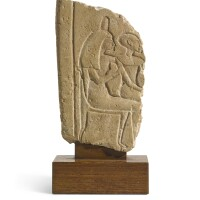 19. a limestone stela fragment, in the egyptian amarna style but probably not ancient   a limestone stela fragment, in the egyptian amarna style but probably not ancient