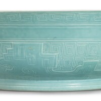 9. a rare carved pale turquoise-enameled'kuilong' bowl yongzheng mark and period