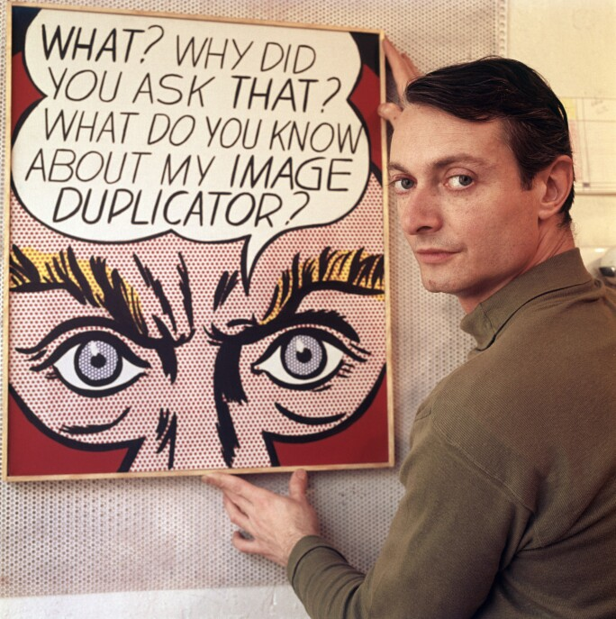 Roy Lichtenstein with one of his paintings, 1964.