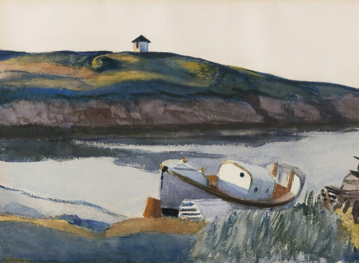 A small white boat docked to to the side of a bay, with a hill in the distant with small white cottage, in twilight.