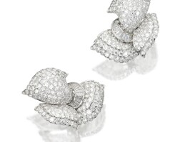104. pair of 18 karat white gold and diamond bow earclips