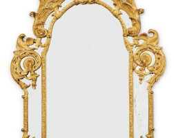 40. a louis xv carved giltwood mirror, circa 1730  