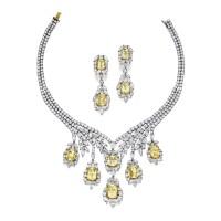 254. 鉑金及14k黃金鑲黃色剛玉配鑽石項鏈一條及耳環一對