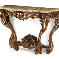 35. a louis xv carved and tinted oak in the manner of pierre contant d'ivry, circa 1750  
