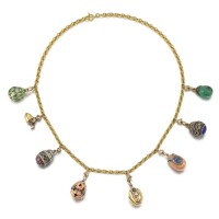 326. a necklace of eight jewelledfabergé egg pendants |