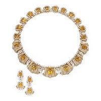 25. 18 karat gold, citrine, diamond and sapphire necklace and earclips