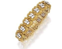 11. 18 karat gold, platinum and diamond bracelet