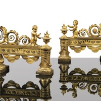 11. a pair of gilt-bronzechenets, in louis xvi style