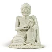 1513. a white-glazed figure of a luohan 20th century |