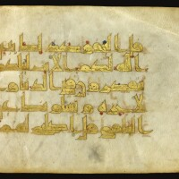 165. a qur'an leaf in gold kufic script on vellum, near east, 10th century