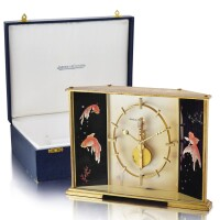 2507. jaeger-lecoultre | a gilt brass table clock with 8-days power reserve, painted koi carp panels and fitted presentation boxno 366 circa 1980