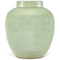 627. a carved celadon-glazed jar qing dynasty, 19th– 20th century