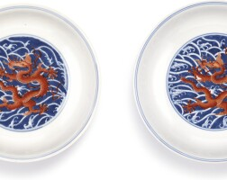 3637. a pair of iron-red and underglaze-blue 'dragon' dishes seal marks and period of qianlong |