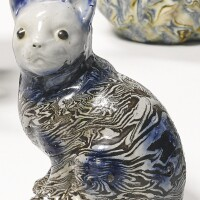 344. staffordshire agateware figure of a seated cat circa 1750-60