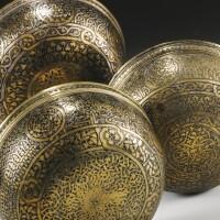 3. three fine veneto-saracenic silver-inlaid brass bowls, probably syria, 14th century