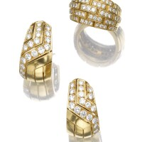 48. pair of diamond ear clips and ring, cartier
