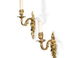 5. a pair of louis xv ormolu single-branch wall lights circa 1735