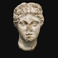 16. a roman marble head of a muse, circa 2nd century a.d. | a roman marble head of a muse