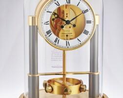2511. jaeger-lecoultre | a gilt brass atmos clockno 0231 serial 600103 made for the 150th anniversary circa 1983