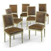 1. a set of seven louis xvi carved and white-painted side chairs circa1775