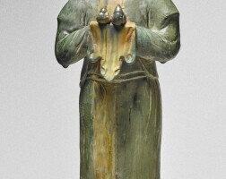 9. a sancai-glazed pottery figure of an attendant tang dynasty