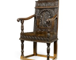16. a charles i carved oak panel back armchair