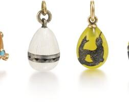 319. a group of six egg pendants