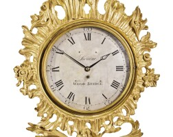 11. a carved giltwood wall timepiece, early 19th century, movement andframe surroundassociated