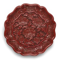 3404. an extremely rare and superbly carved cinnabar lacquer 'peony' dish mark and period of yongle |