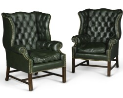 160. a pair of george iii style leather upholstered wing armchairs |