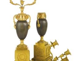 137A. a pair of restauration ormolu and patinated bronze four-branch candelabra circa 1820